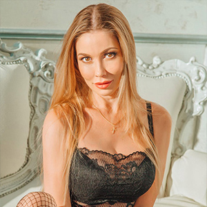 Liv - Escort Models in Aachen turn on with Erotic Feet and Fishnet Stockings in intimate Togetherness